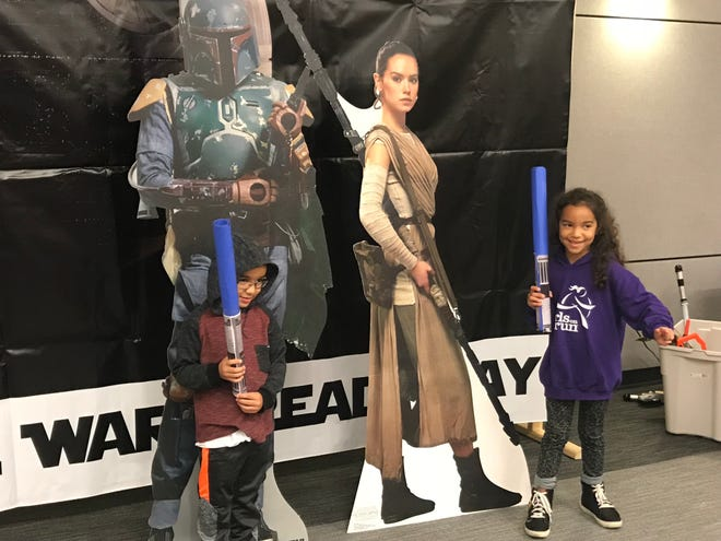 Keegan (left) and Blake Jamison of Farmington Hills pose for photos with Boba Fett and Rey.