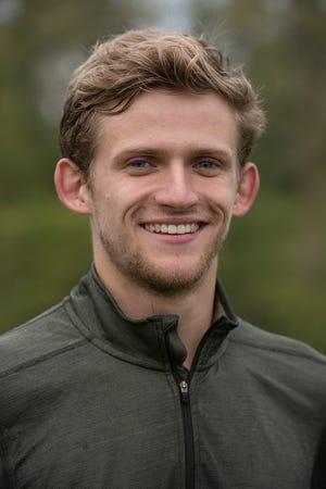 Ryan Karr, of Canton, is training for the Ironman Kona in Hawaii.