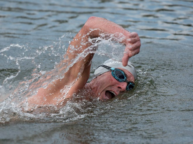 Jimi Young trains for the swimming part of the Ironman Kona.