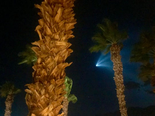 A SpaceX rocket lights up the night sky over the Coachella Valley Sunday night.