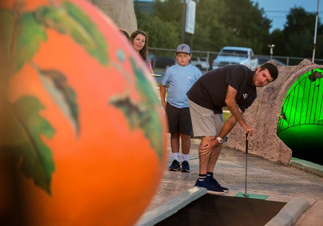 Pro golfer Bubba Watson watches his ball after a putt Sunday,October 7, 2018, duirng the First Tee of Northwest Florida's 2nd Annual Mini-Golf Championship hosted by Bubba Watson at the Goofy Golf on Navy Blvd.