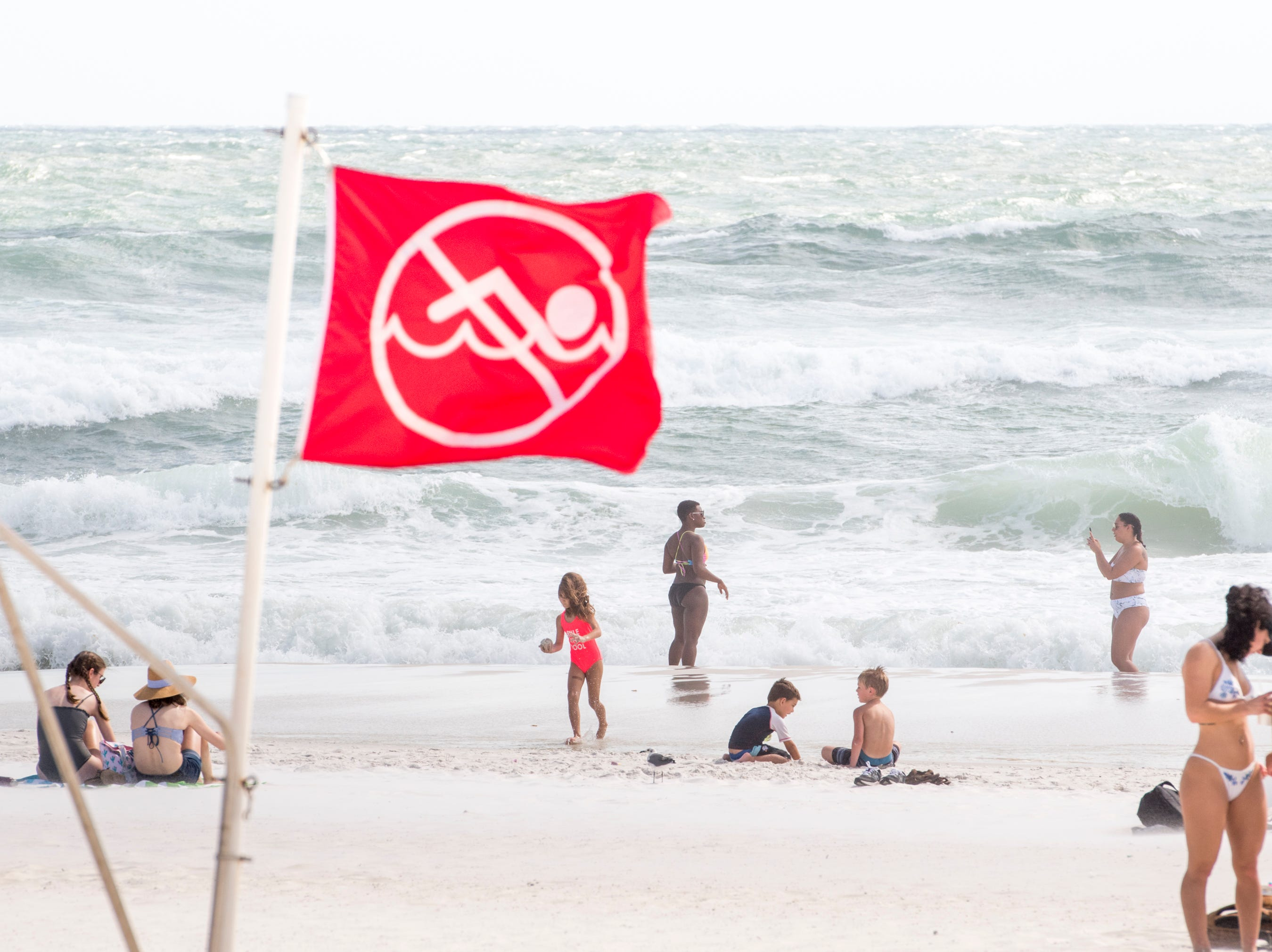 Even though no swimming is allowed in the Gulf of Mexico, beachgoers still enjoy themselves as Huricane Michael approaches the Florida panhandle on Monday, October 8, 2018.