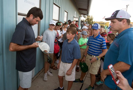 Pro golfer Bubba Watson signs autographs Sunday,October 7, 2018, duirng the First Tee of Northwest Florida's 2nd Annual Mini-Golf Championship hosted by Bubba Watson at the Goofy Golf on Navy Blvd.