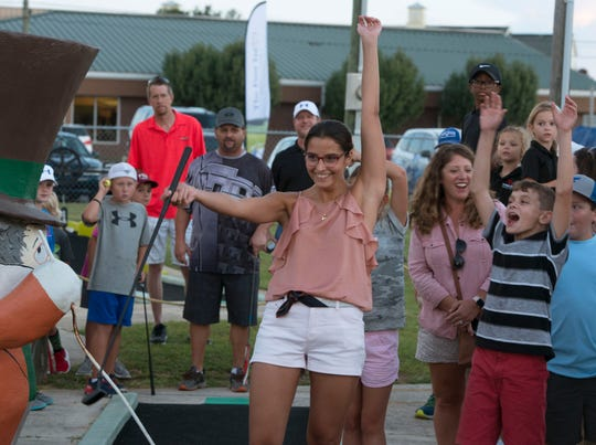 Clara Del Rio Gamera celebrates after getting a hole in one Sunday,October 7, 2018, duirng the First Tee of Northwest Florida's 2nd Annual Mini-Golf Championship hosted by Bubba Watson at the Goofy Golf on Navy Blvd.
