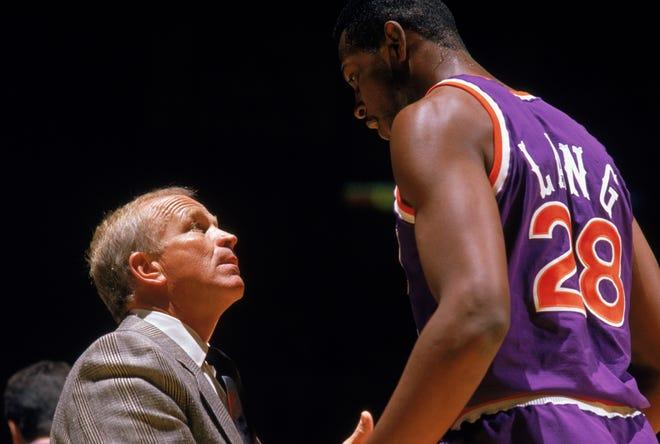Head Coach Cotton Fitzsimmons of the Phonenix Suns talks with Andrew Lang #28 during a 1989 season NBA game at Veteran's Memorial Coliseum in Phoenix, Arizona.