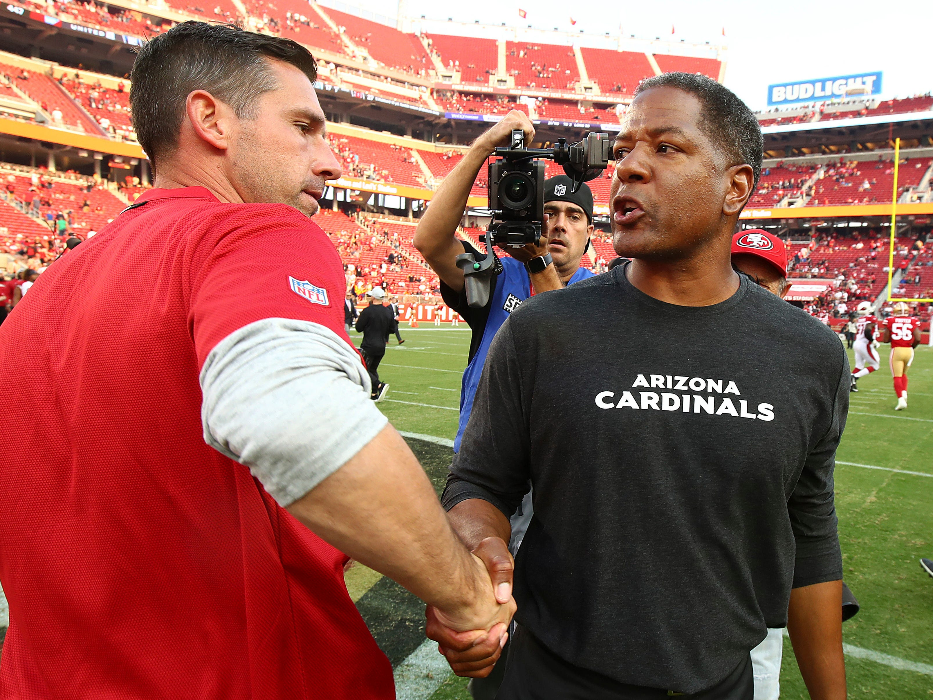 San Francisco 49ers head coach Kyle Shanahan, left, shakes hands with Arizona Cardinals head coach Steve Wilks after an NFL football game in Santa Clara, Calif., Sunday, Oct. 7, 2018.