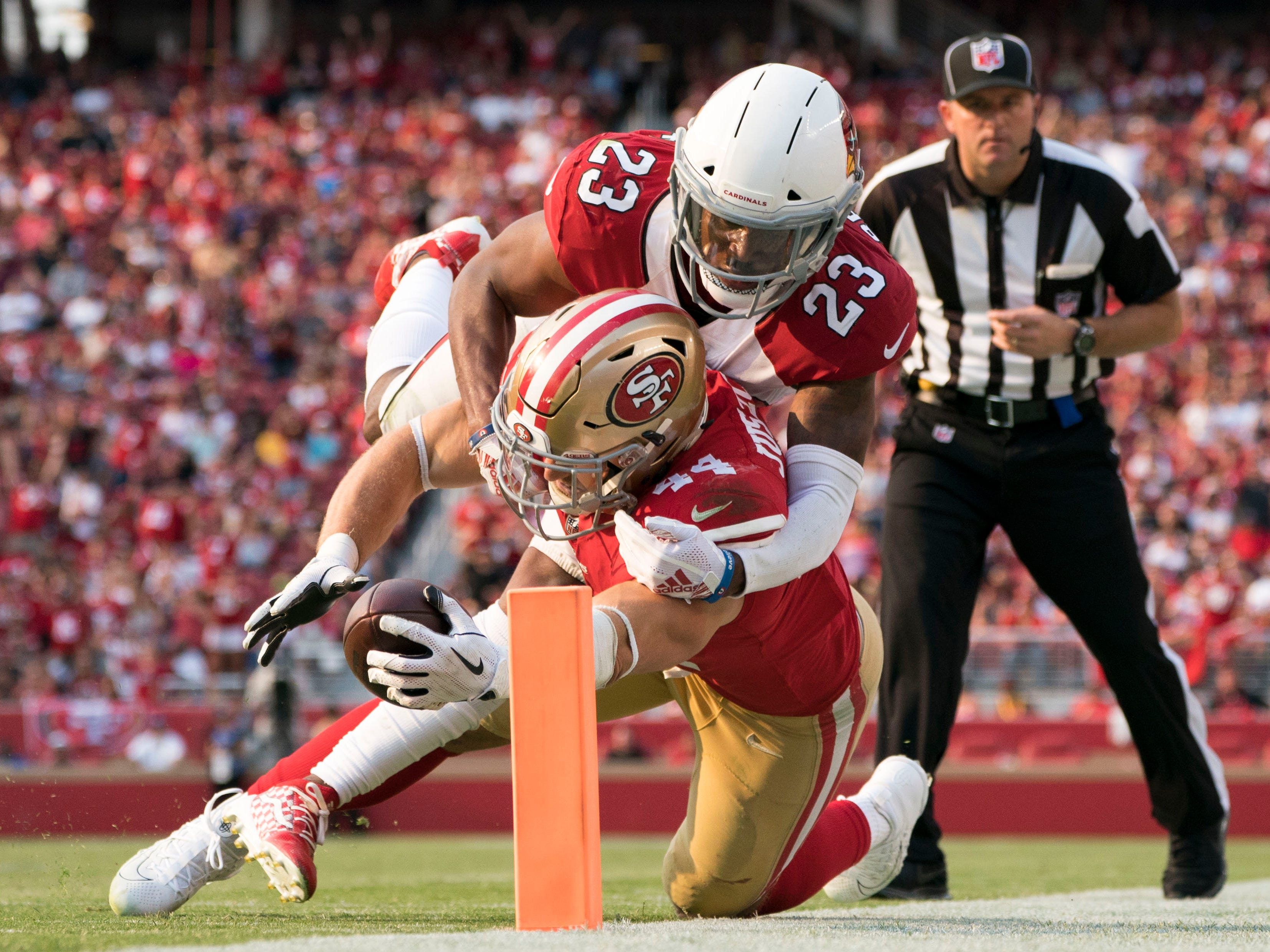 October 7, 2018; Santa Clara, CA, USA; San Francisco 49ers running back Kyle Juszczyk (44) is tackled by Arizona Cardinals defensive back Bene Benwikere (23) during the fourth quarter at Levi's Stadium.