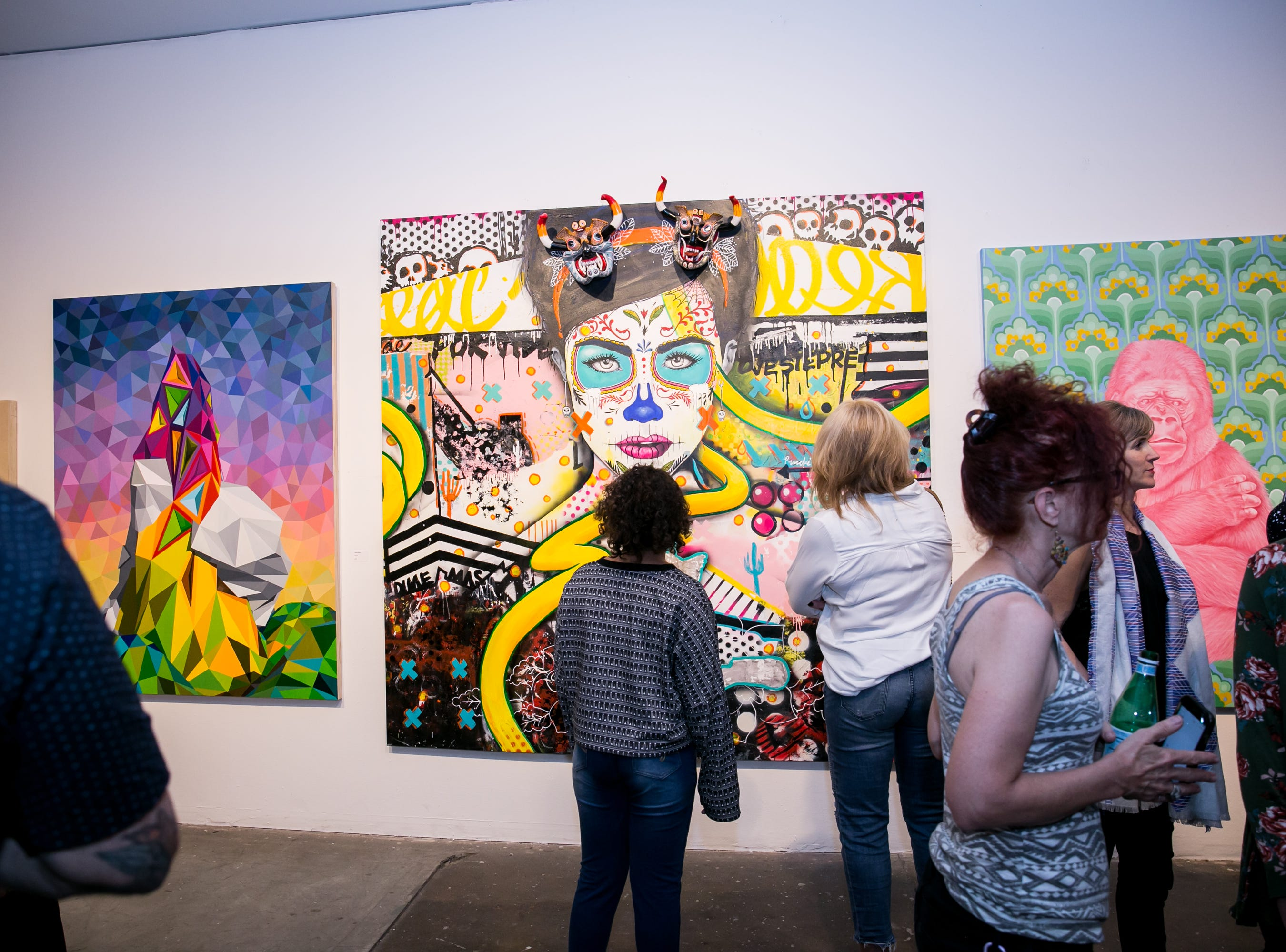 Attendees scope out amazing art during Chaos Theory 19 at Legend City Studios during First Friday on October 5, 2018.