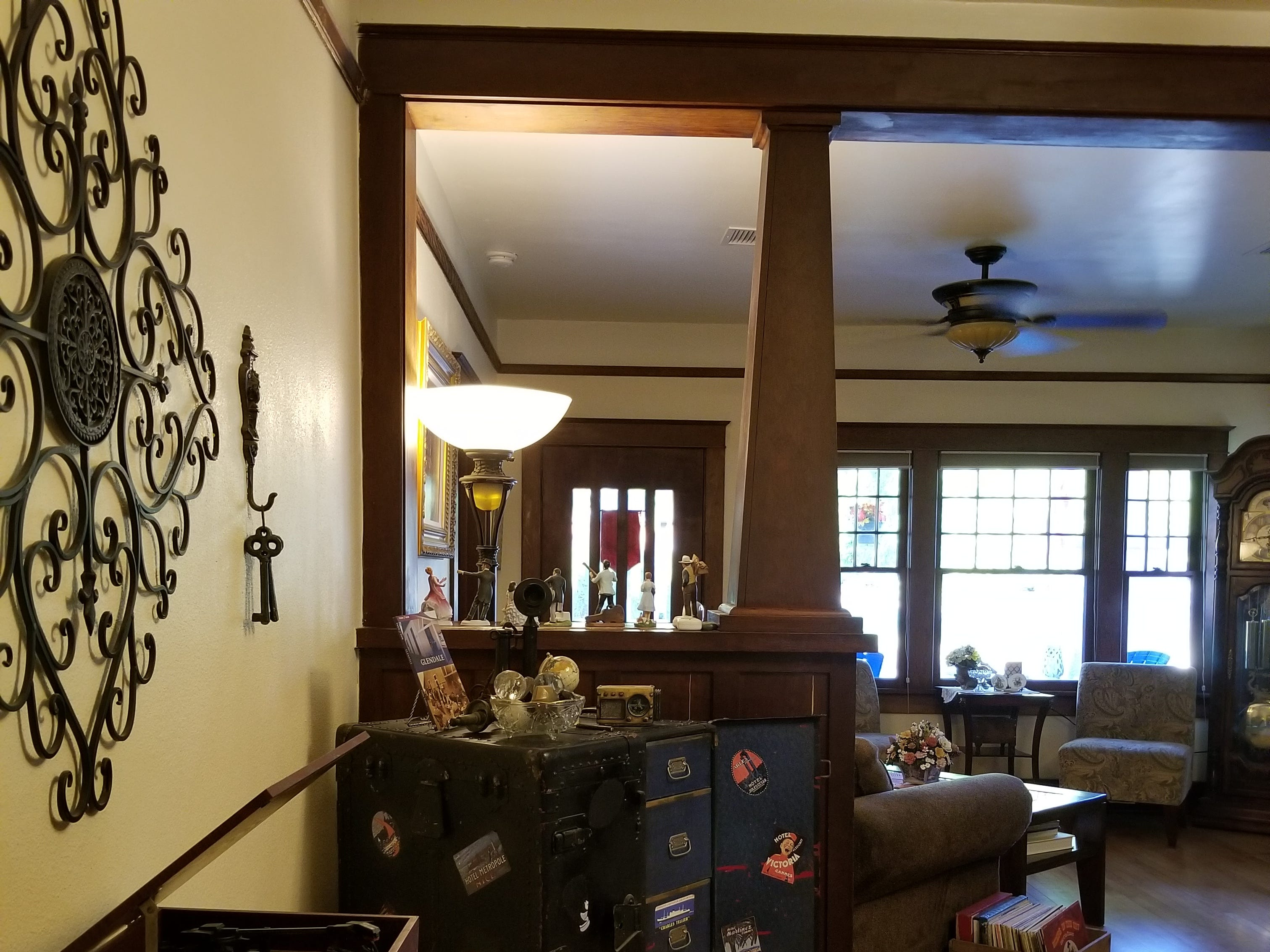 The dining room features antique luggage found at a family garage sale.