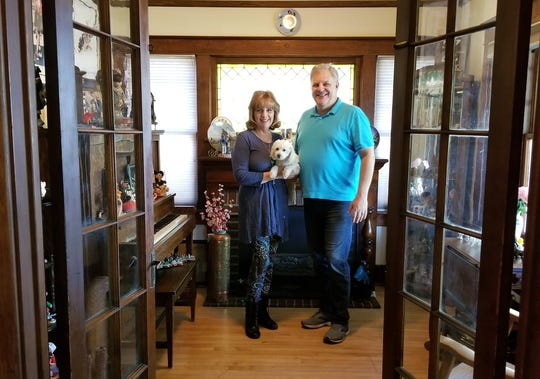 Bud and Lorraine Zomok pose for a picture in their home.