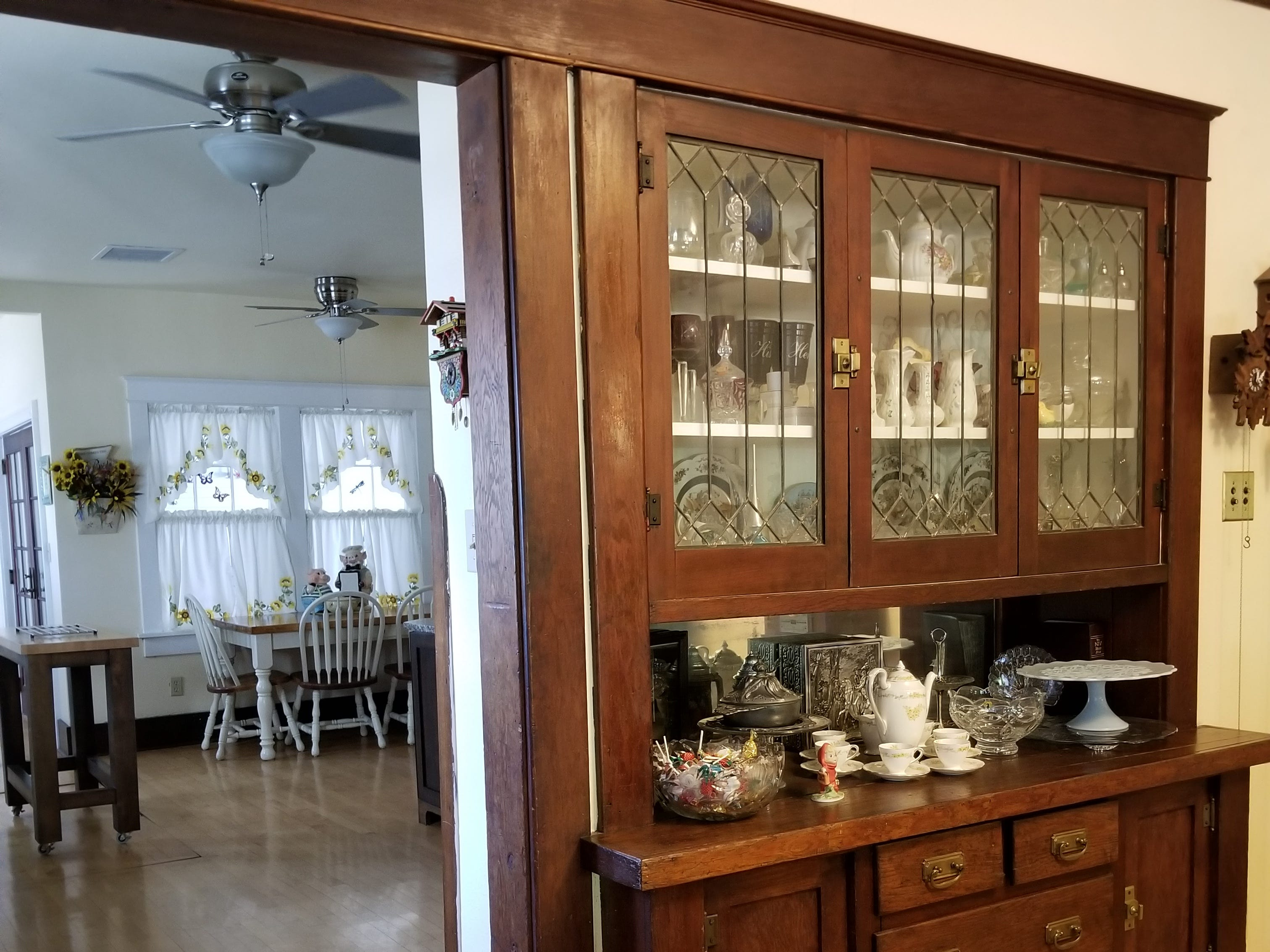 The dining room centerpiece is a built-in china cabinet that has withstood the test of time. Leaded glass panels in the cabinet doors reflect the history of the room.