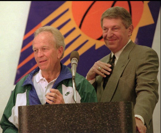 Cotton Fitzsimmons (left) and Suns owner and team president Jerry Colangelo answer questions during a news conference naming Fitzsimmons as the Suns' new head coach on Jan. 16, 1996.