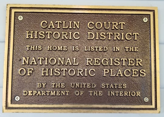 National Register of Historic Places plaque affixed to front entrance of the home.