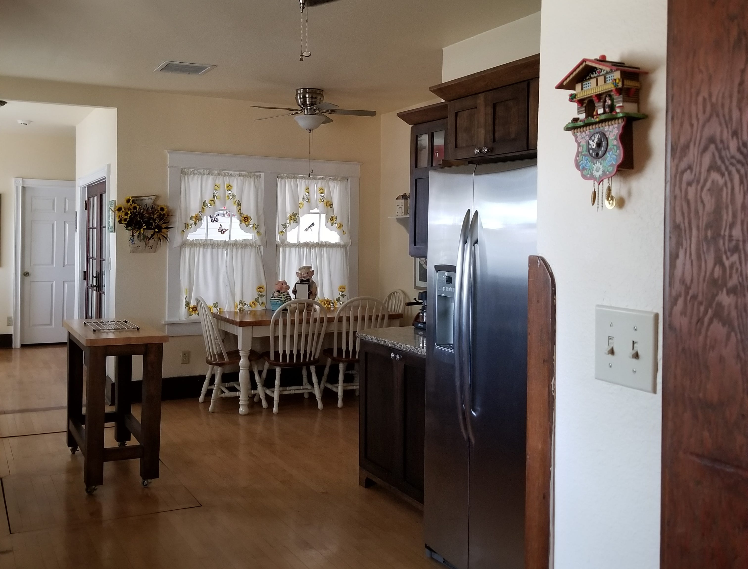 The kitchen was completely remodeled with updated appliances and cabinetry to keep up with Bud's cooking prowess.  Though updated, the room honors the era the home was built with the touch of crisp white curtains handmade by Bud's mother.