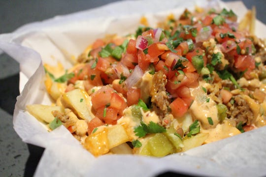 The new Suns Spicy Southwest Loaded Fries offer local flavor with Schreiner's chorizo, black bean salsa, roasted green chiles and fried tortilla strips.