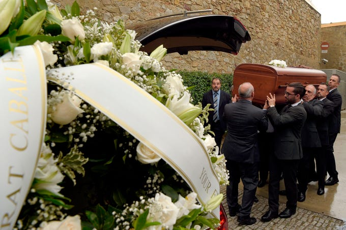 The coffin with the remains of Spanish opera singer Montserrat Caballe is carried during her funeral in Barcelona on Oct. 8, 2018.