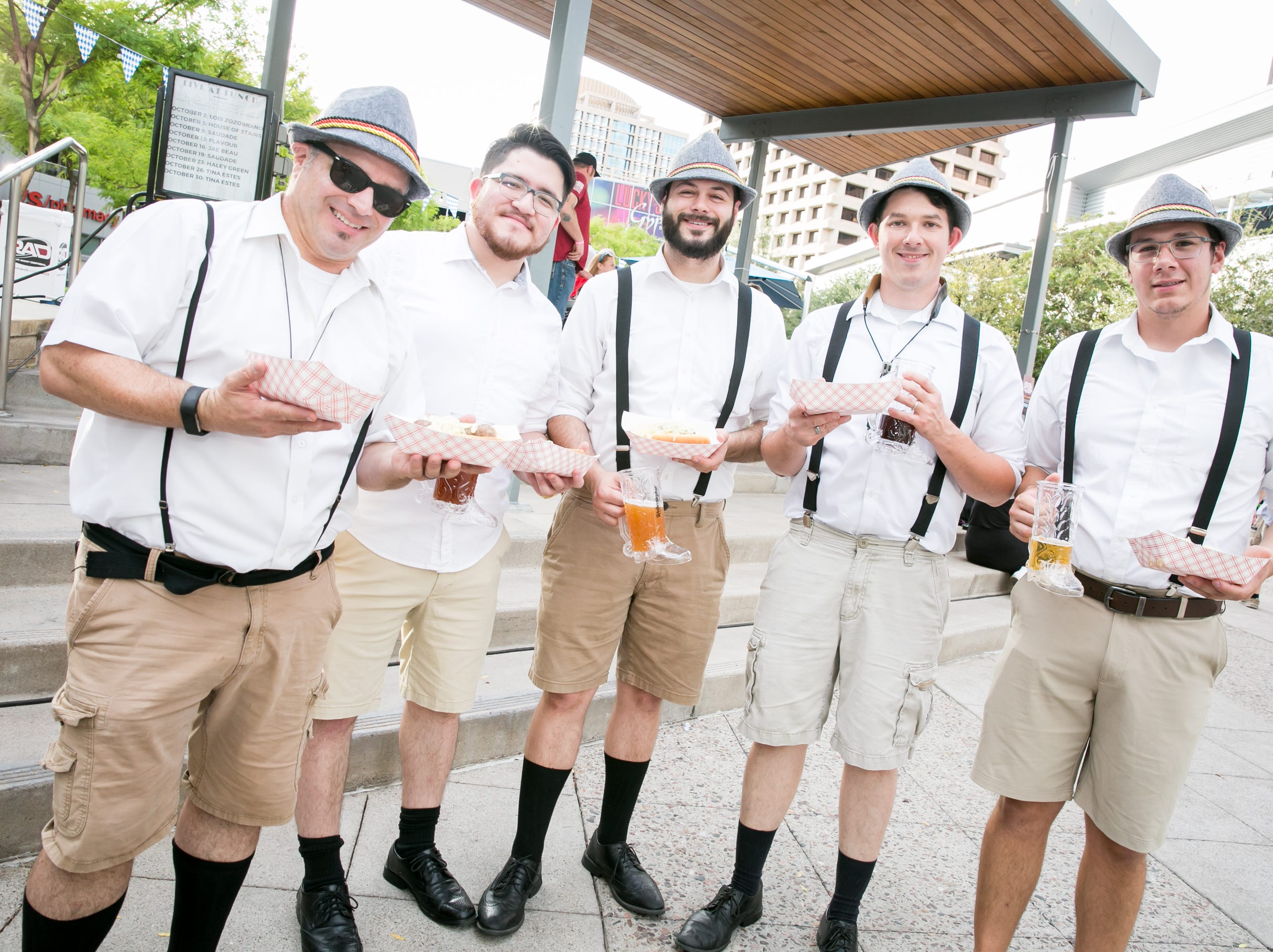 The Funkhouse Brass Band enjoyed some food before performing during Downtown Phoenix Oktoberfest at CityScape on Saturday, October 6, 2018.