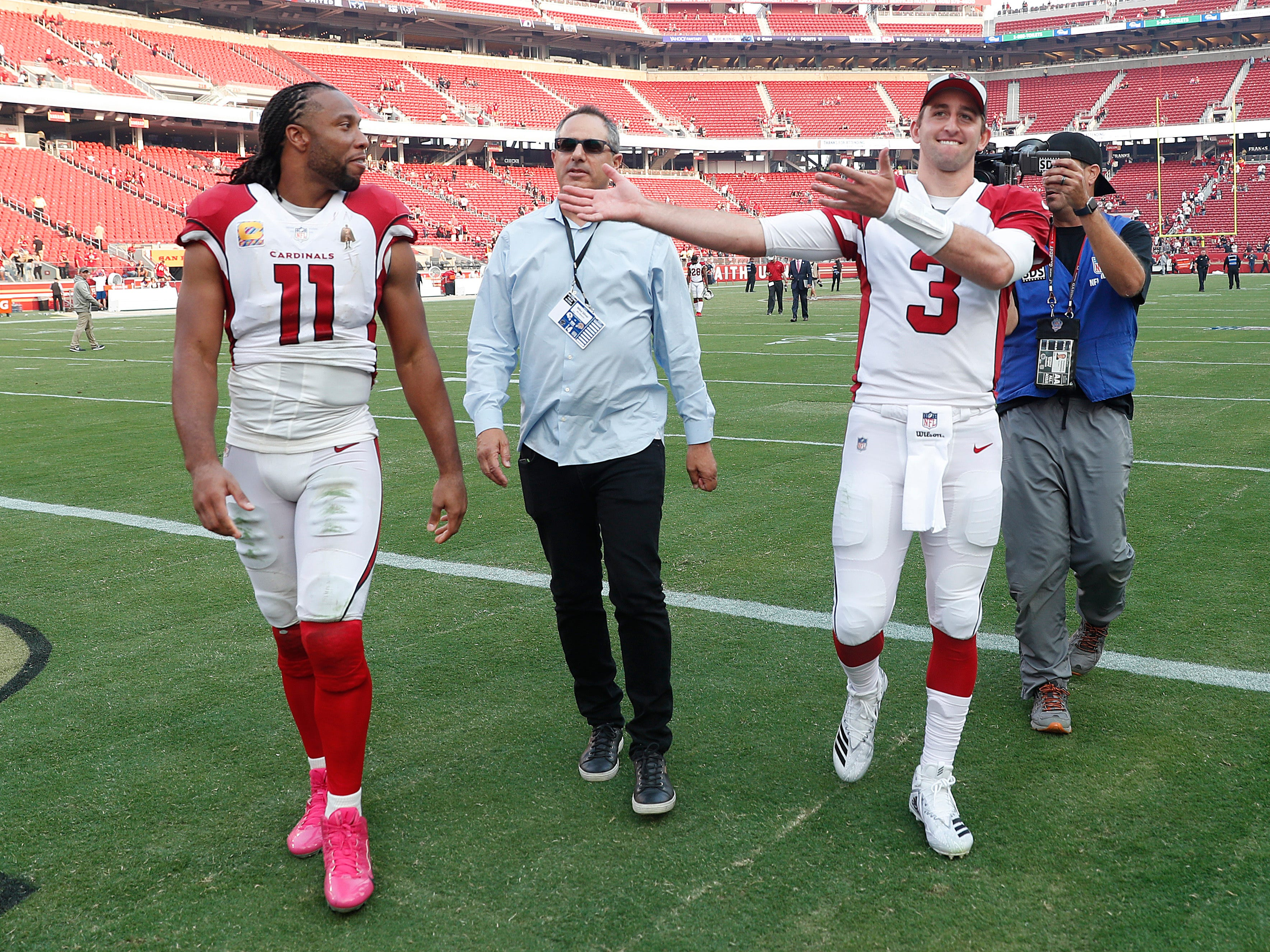 Arizona Cardinals wide receiver Larry Fitzgerald (11) and quarterback Josh Rosen (3) walk off the field after an NFL football game against the San Francisco 49ers in Santa Clara, Calif., Sunday, Oct. 7, 2018.