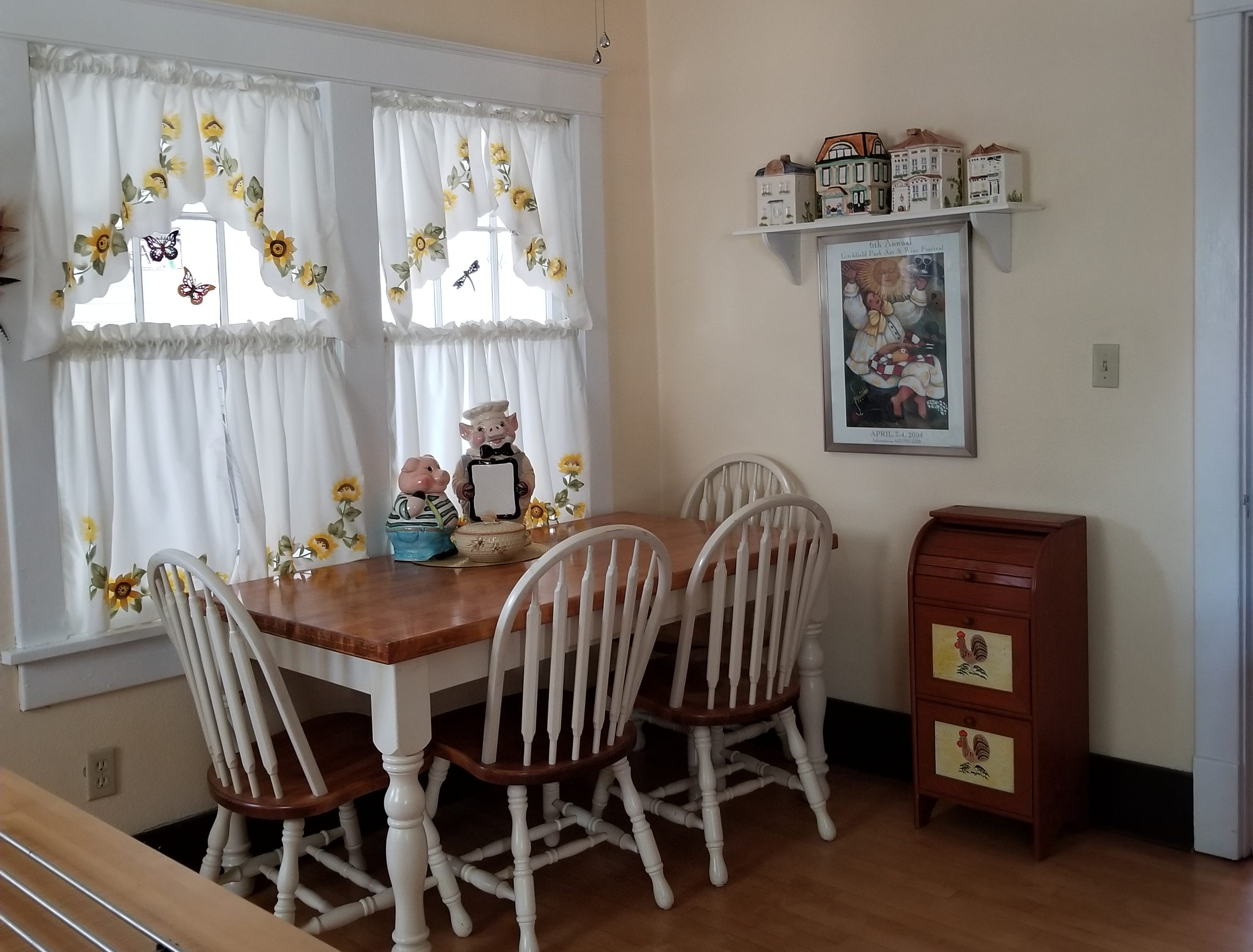 The kitchen has ample room for a full-sized table with windows overlooking the breezeway.
