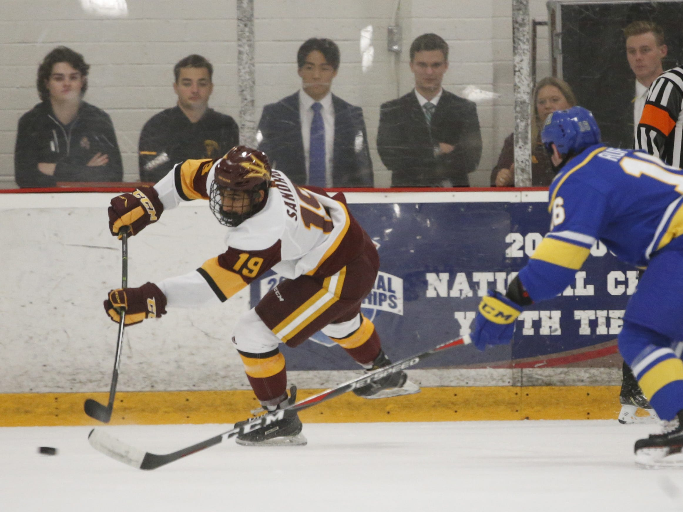 ASU's Jordan Sandhu (19) passes against Alaska's Sam Ruffin (16) at Oceanside Ice Arena in Tempe, Ariz. on October 7, 2018.