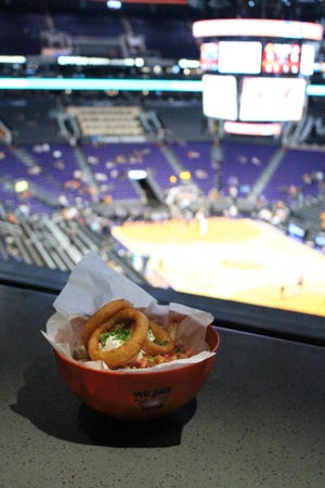 Colossal Loaded Fries and Rings come served in a souvenir basketball bowl.