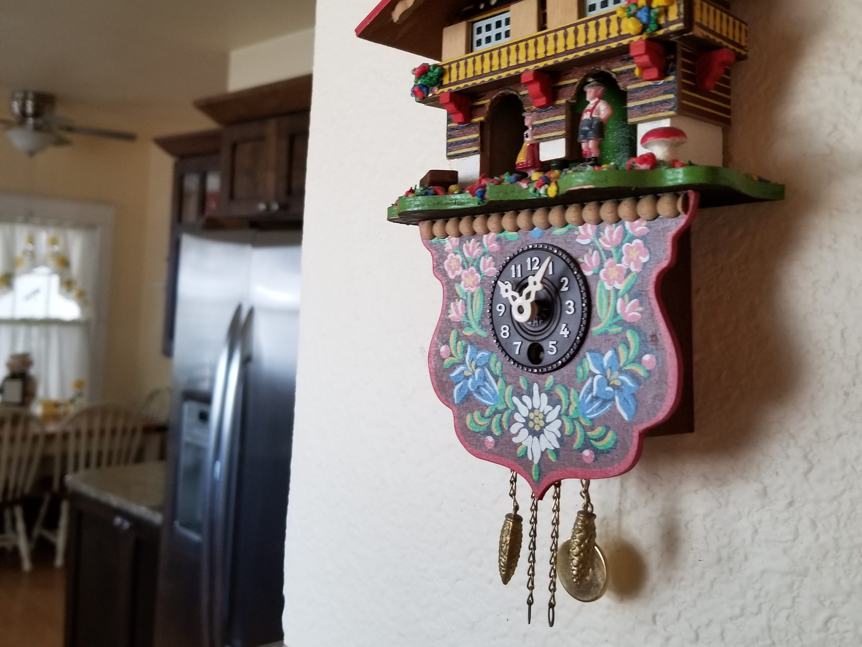 One is welcomed to the kitchen by an wall clock passed on by Lorraine's parents.