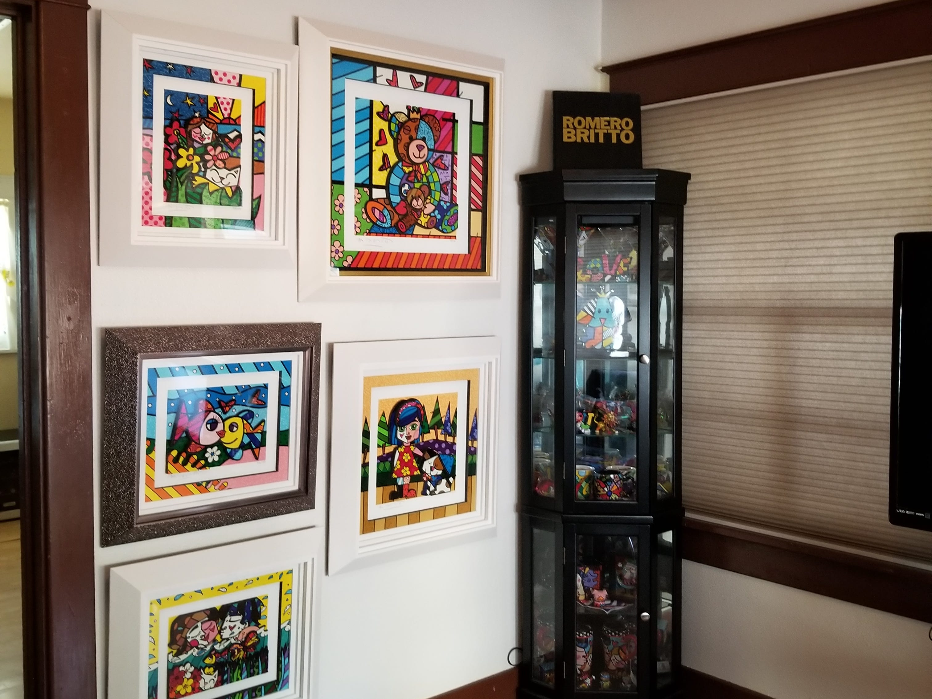 Bud painted the family room in bold primary color bands above the high wall moldings to compliment the artwork in their collection.