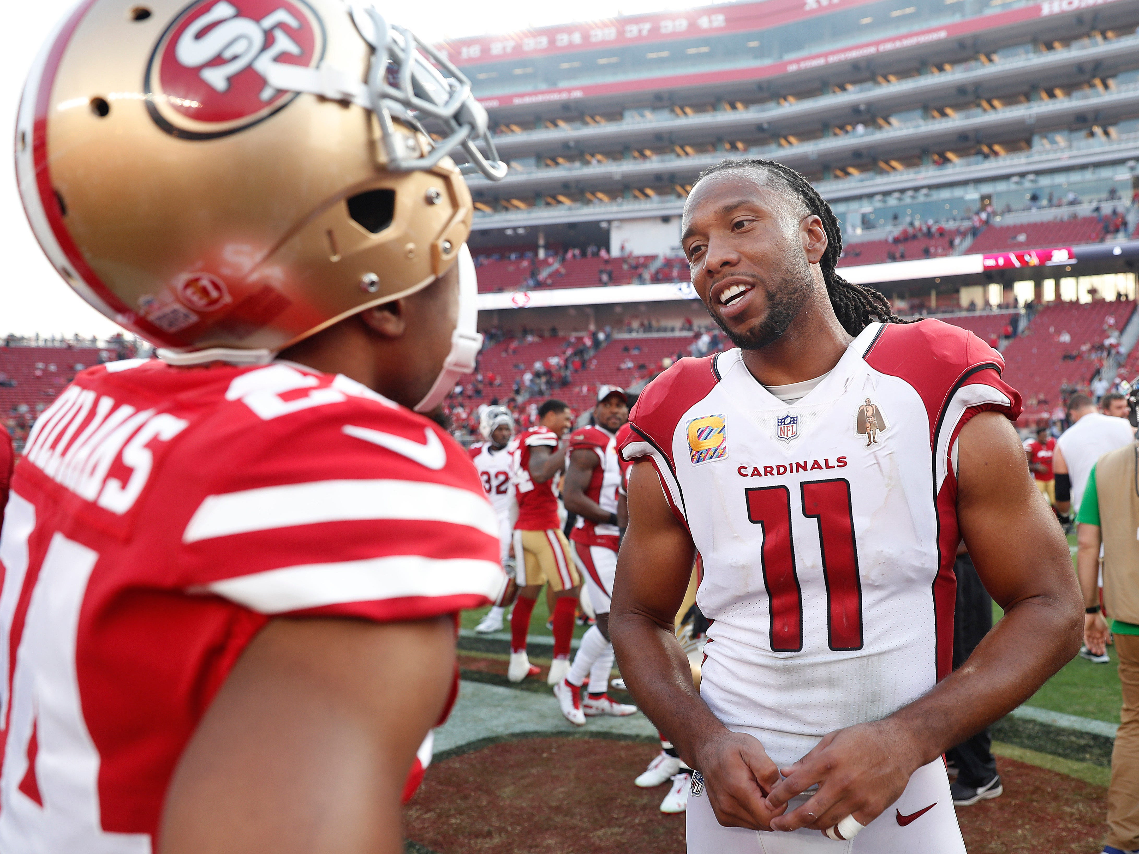 Arizona Cardinals wide receiver Larry Fitzgerald (11) talks with San Francisco 49ers defensive back K'Waun Williams after an NFL football game in Santa Clara, Calif., Sunday, Oct. 7, 2018.