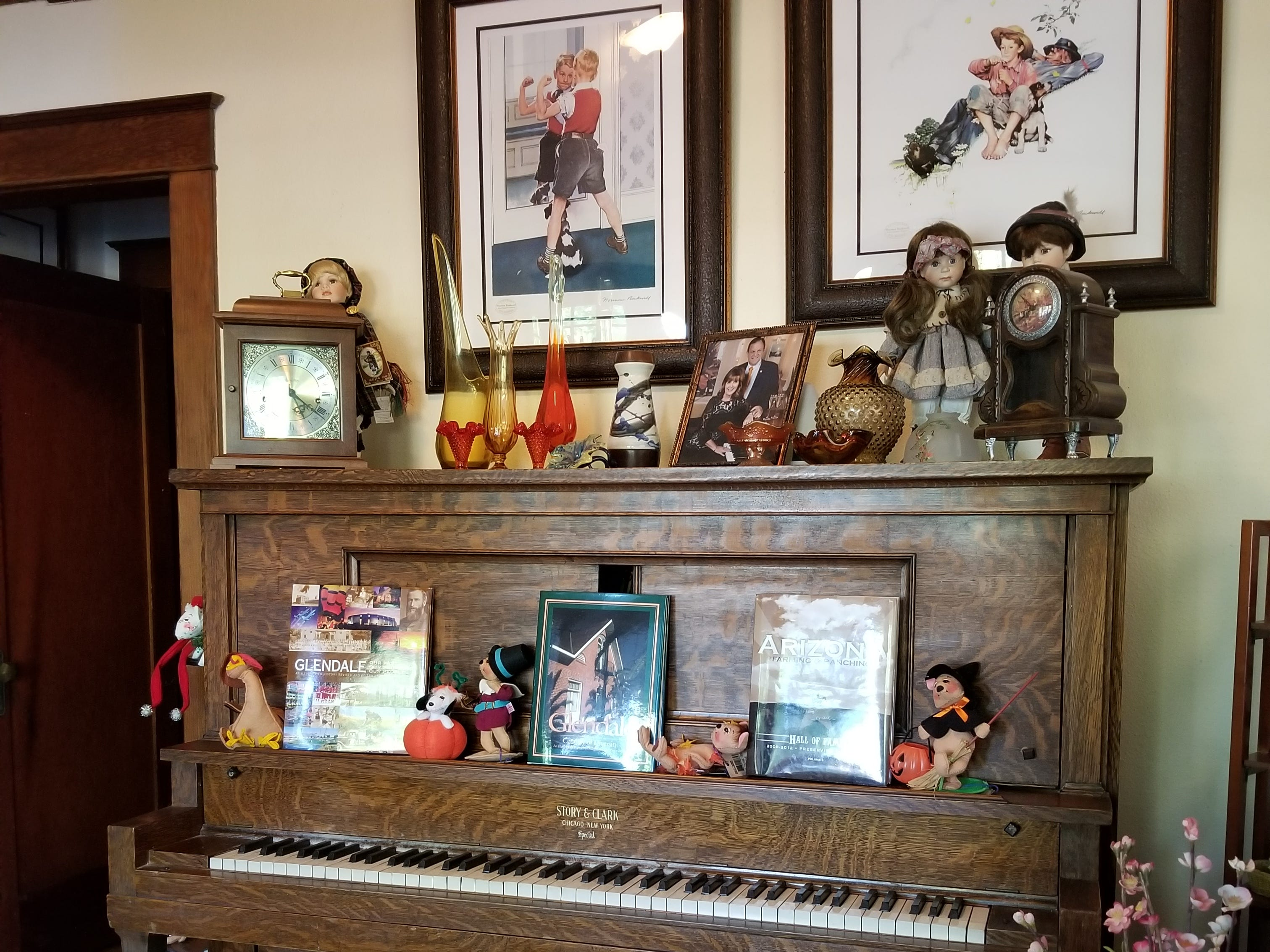 An impressive Story & Clark antique piano holds court in the Zomok's parlor.