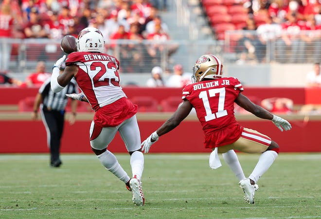 Arizona Cardinals defensive back Bene' Benwikere (23) intercepts a pass in front of San Francisco 49ers wide receiver Victor Bolden Jr. (17) during the second half of an NFL football game in Santa Clara, Calif., Sunday, Oct. 7, 2018.