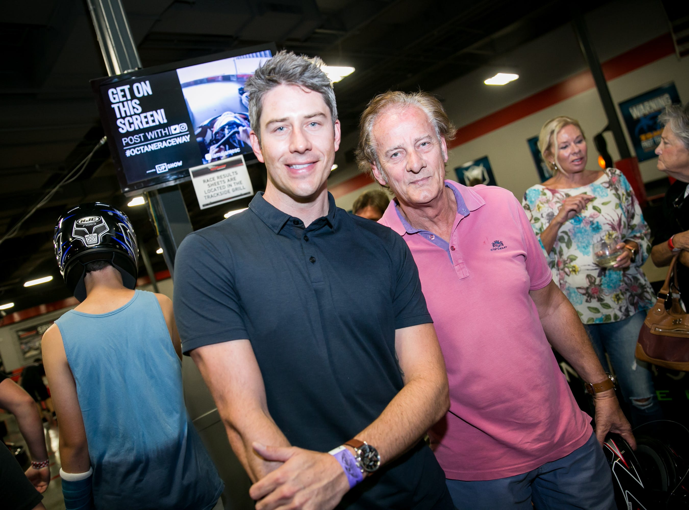 Arie Luyendyk Jr. poses with his dad during Octane Raceway's 15th Anniversary Party in Scottsdale on Saturday, October 6, 2018.