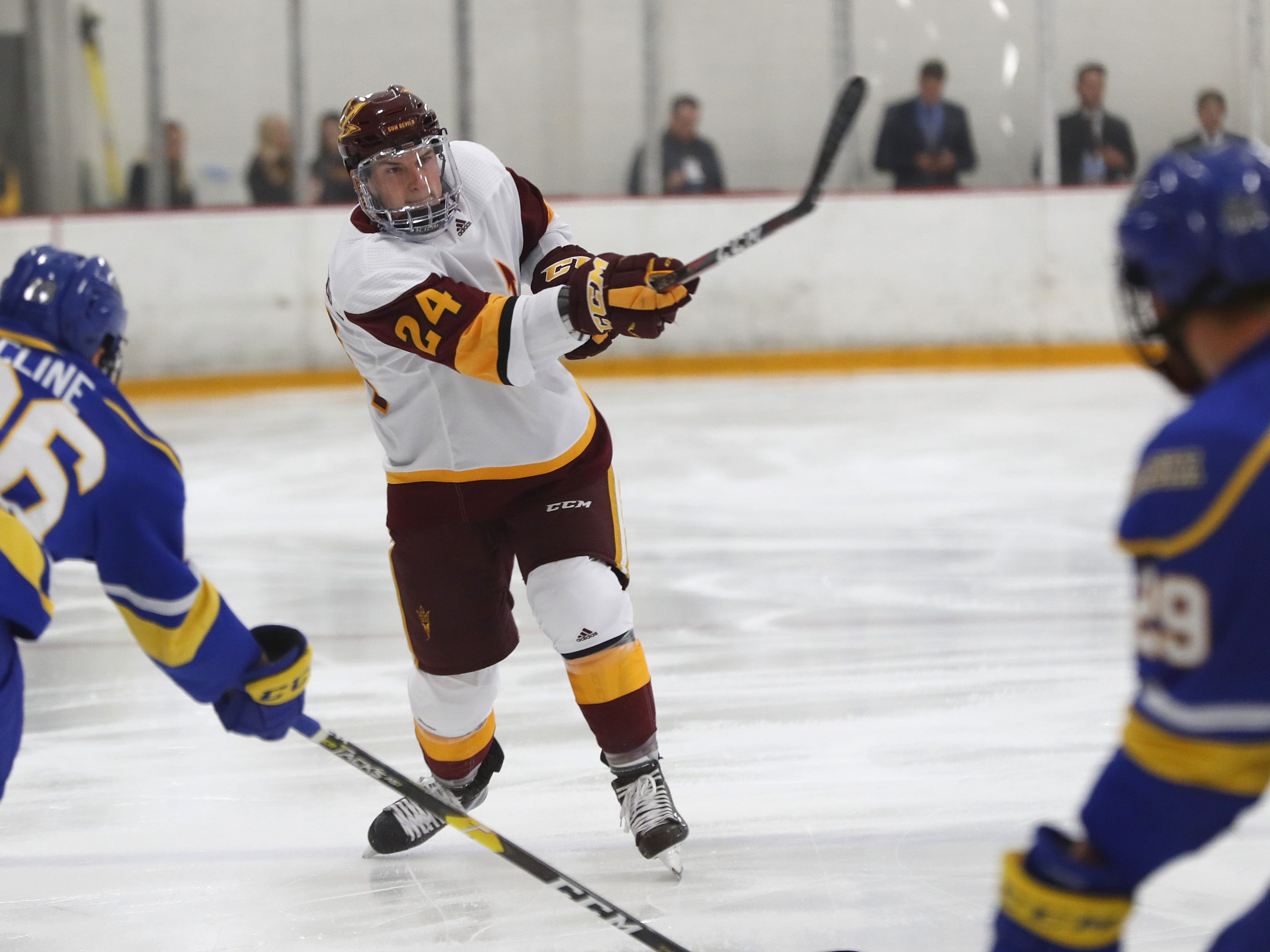 ASU's Joshua Maniscalco (24) shoots against Alaska at Oceanside Ice Arena in Tempe, Ariz. on October 7, 2018.