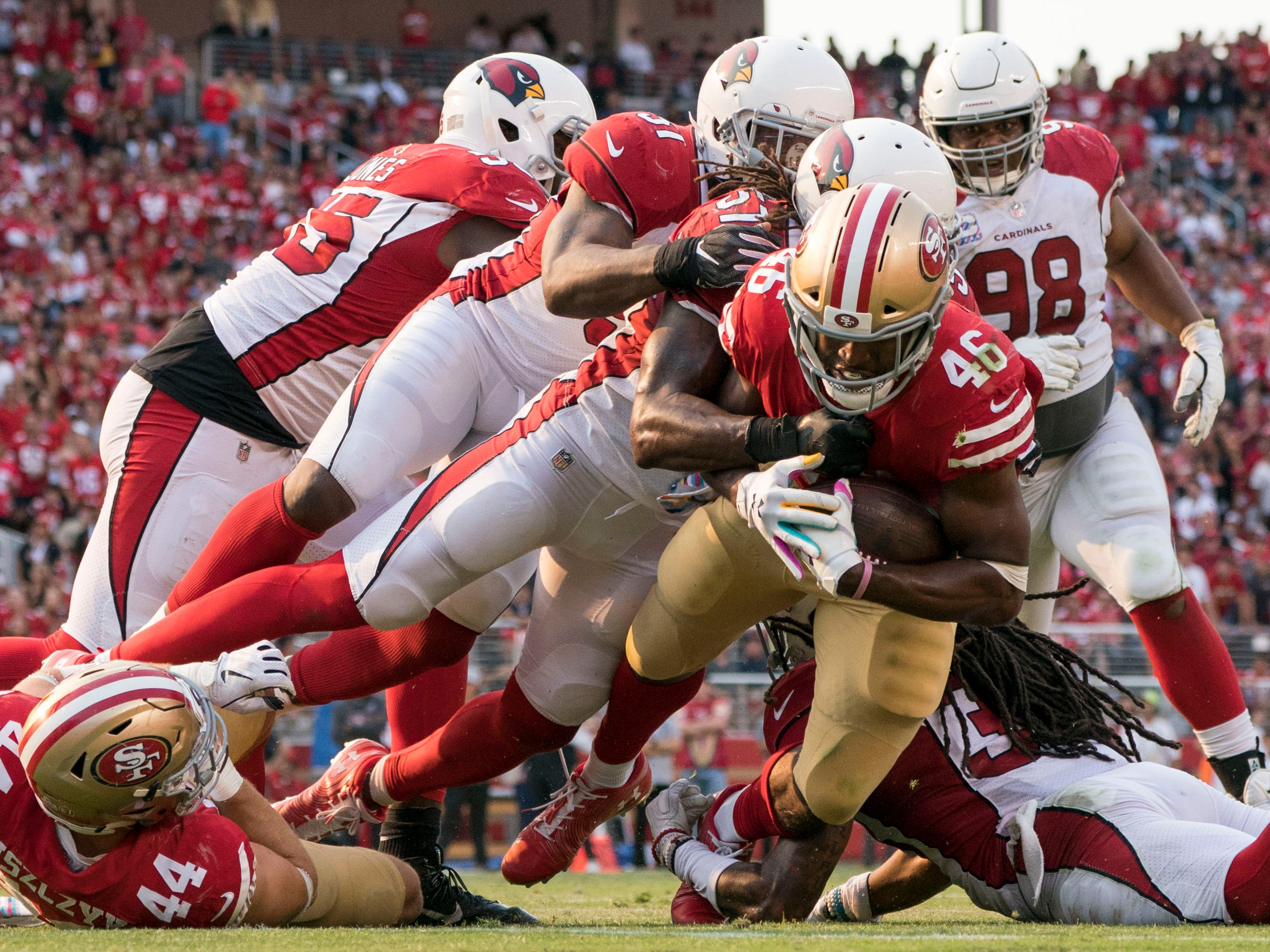 October 7, 2018; Santa Clara, CA, USA; San Francisco 49ers running back Alfred Morris (46) is tackled by the Arizona Cardinals during the fourth quarter at Levi's Stadium.