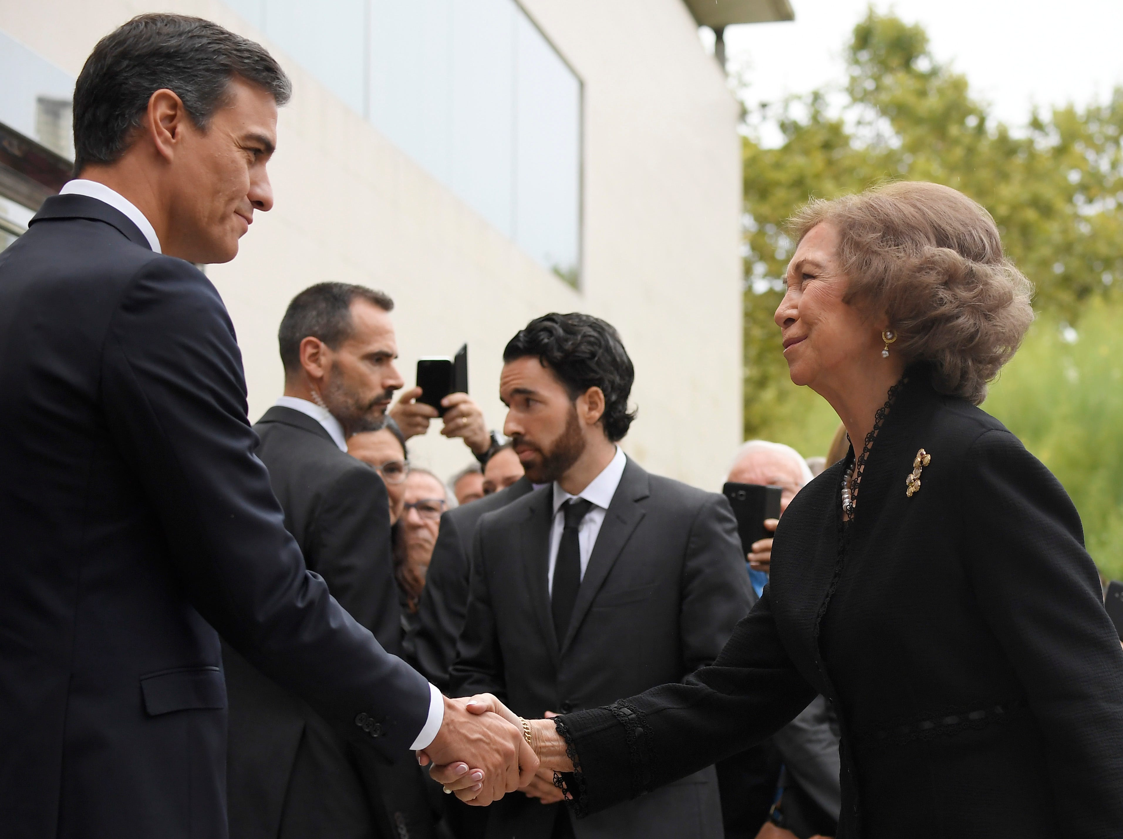 Spanish Prime Minister Pedro Sanchez shakes hands with former queen of Spain, Sofia, during the funeral for Spanish opera singer Montserrat Caballe in Barcelona on Oct. 8, 2018.