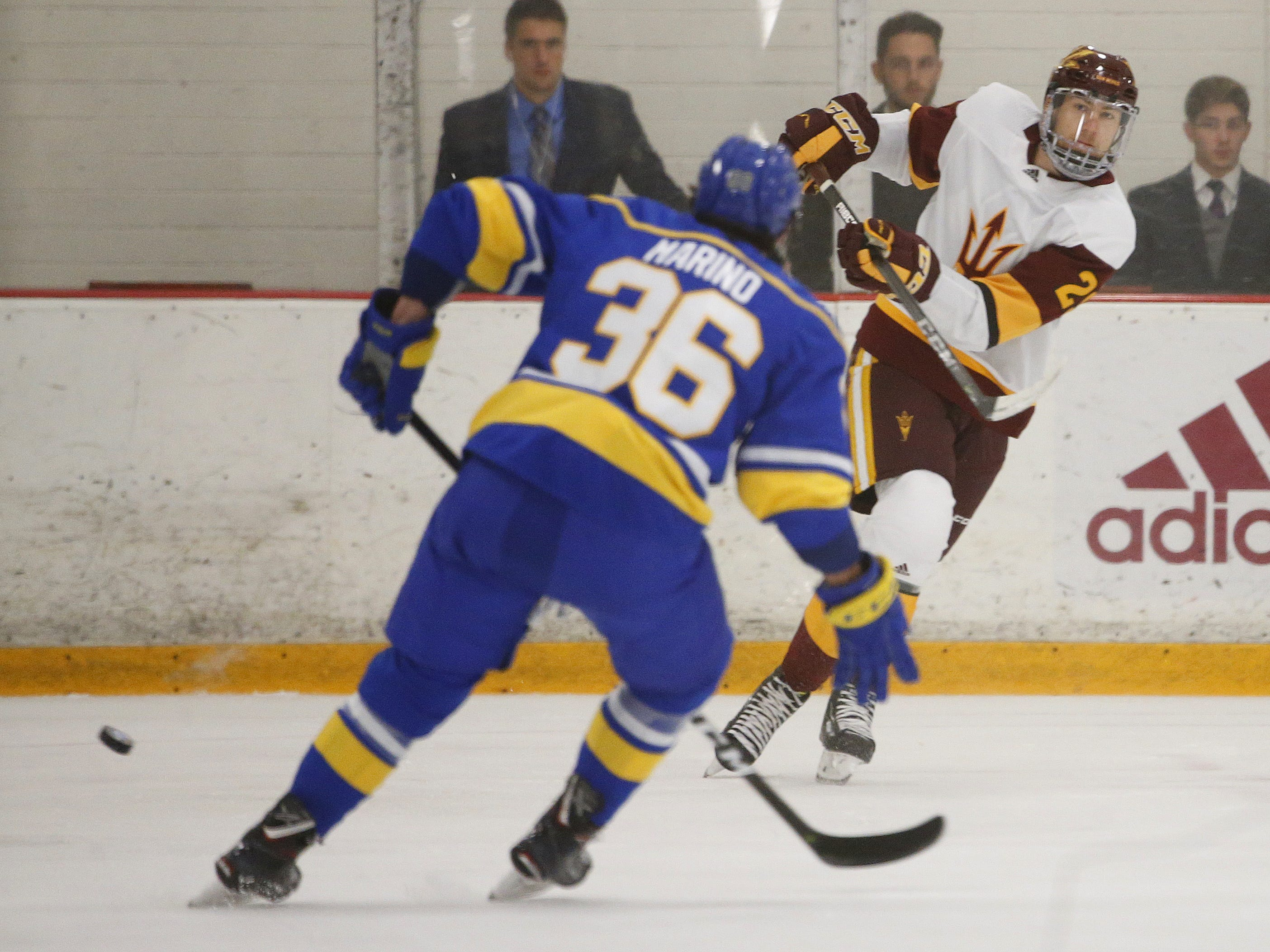 ASU's PJ Marrocco (25) passes against Alaska's Kyle Marino (36) at Oceanside Ice Arena in Tempe, Ariz. on October 7, 2018.