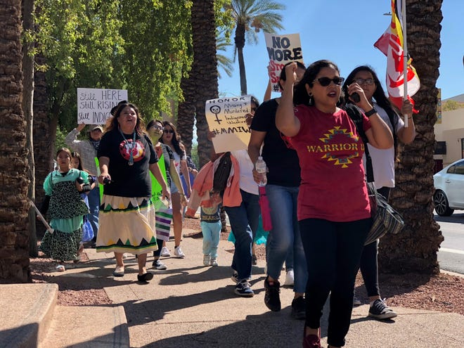 The Indigenous Peoples March makes its way through downtown Phoenix on Van Buren Street Monday morning.