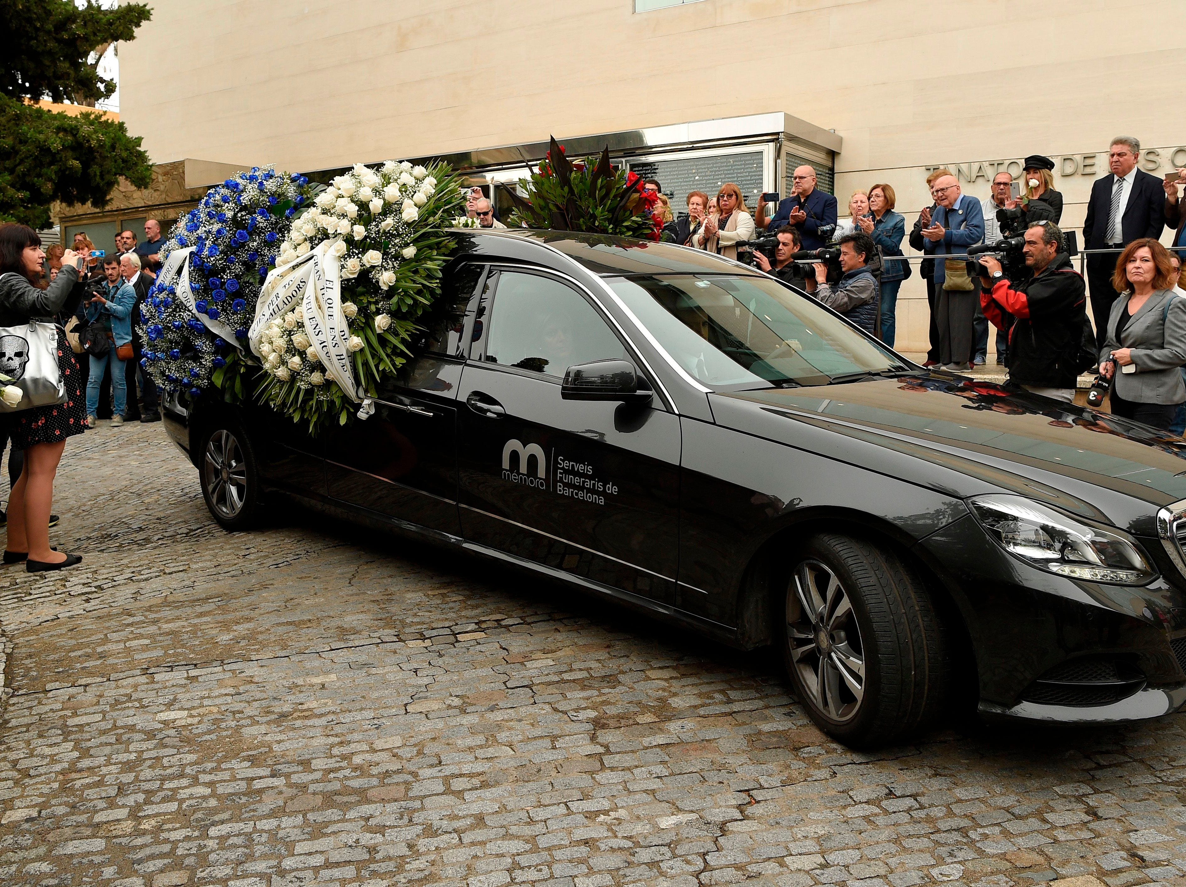 A hearse carries the remains of Spanish opera singer Montserrat Caballe, during her funeral in Barcelona on Oct. 8, 2018.