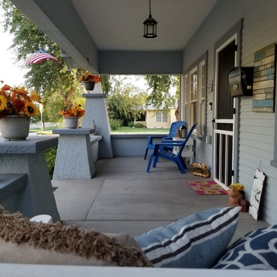 The home features a wide front porch.