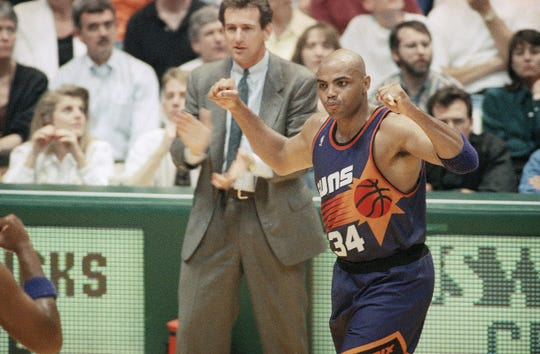Charles Barkley celebrates a Game 3 win with coach Paul Westphal in the Western Conference finals in 1993.