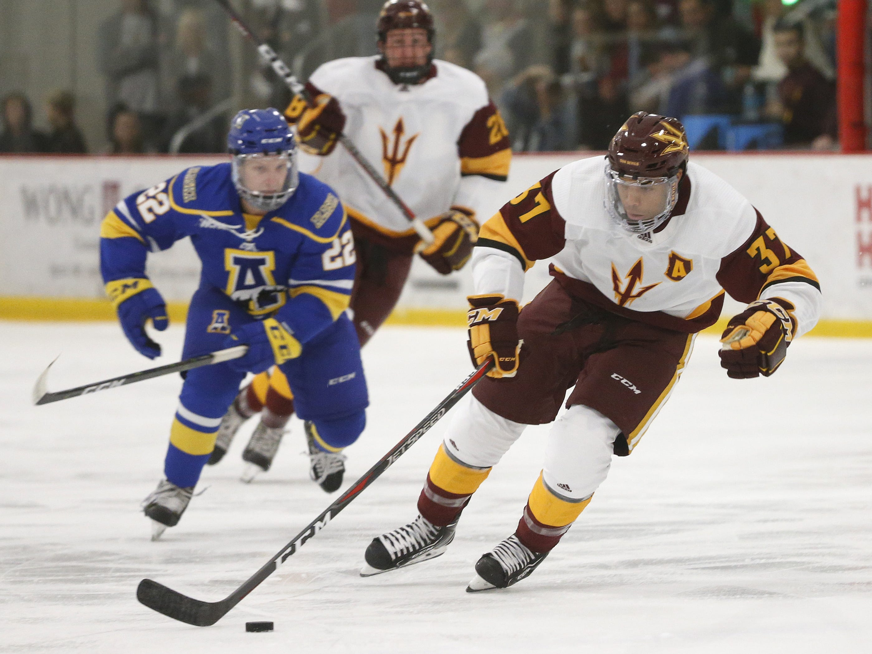 ASU's Dominic Garcia (37) skates up the ice against Alaska's Chad Staley (22) at Oceanside Ice Arena in Tempe, Ariz. on October 7, 2018.