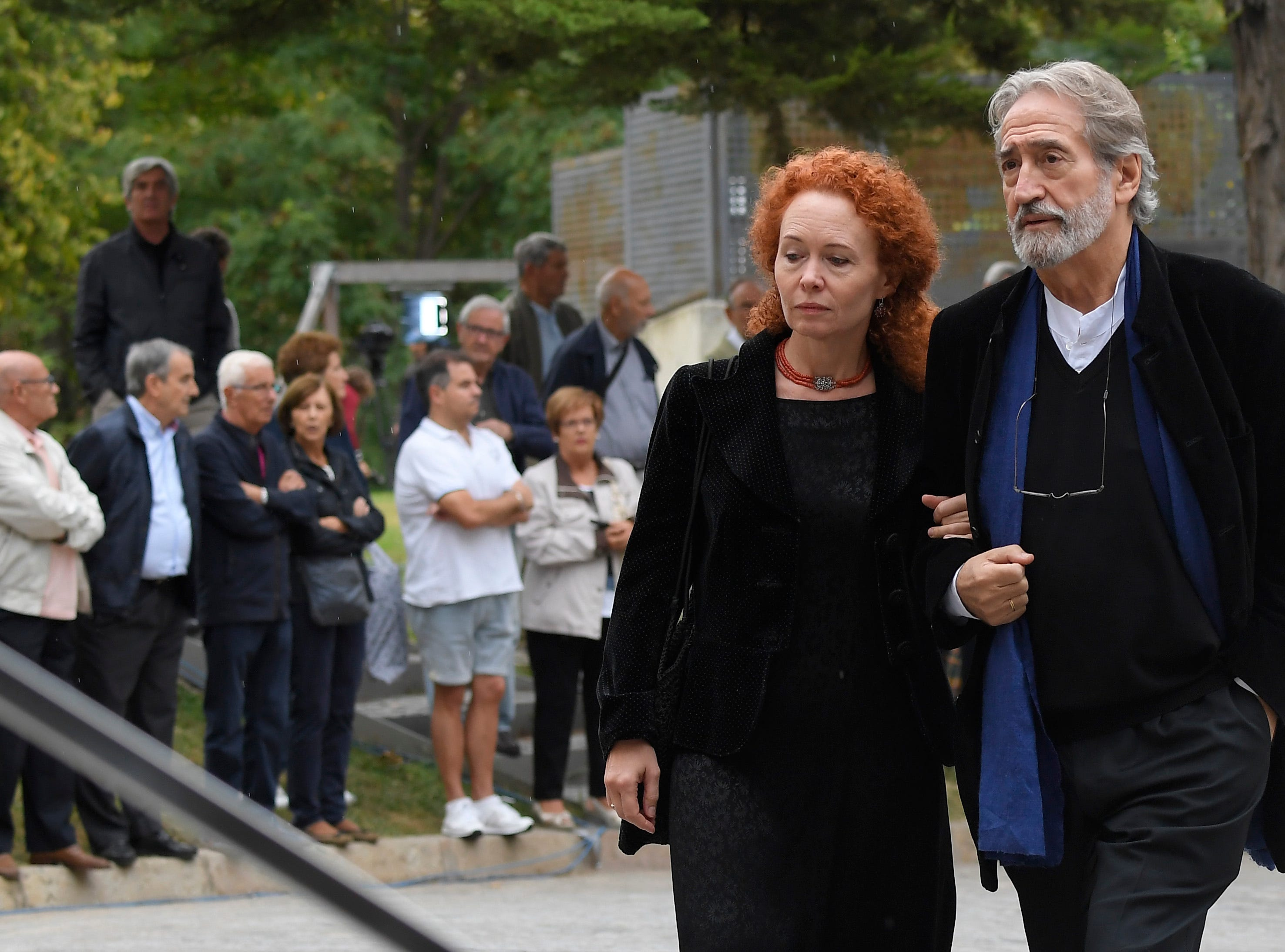 Conductor and viol player, Jordi Savall  and his wife, philosopher Maria Bartels, arrive to attend the funeral for Spanish opera singer Montserrat Caballe in Barcelona on Oct. 8, 2018.