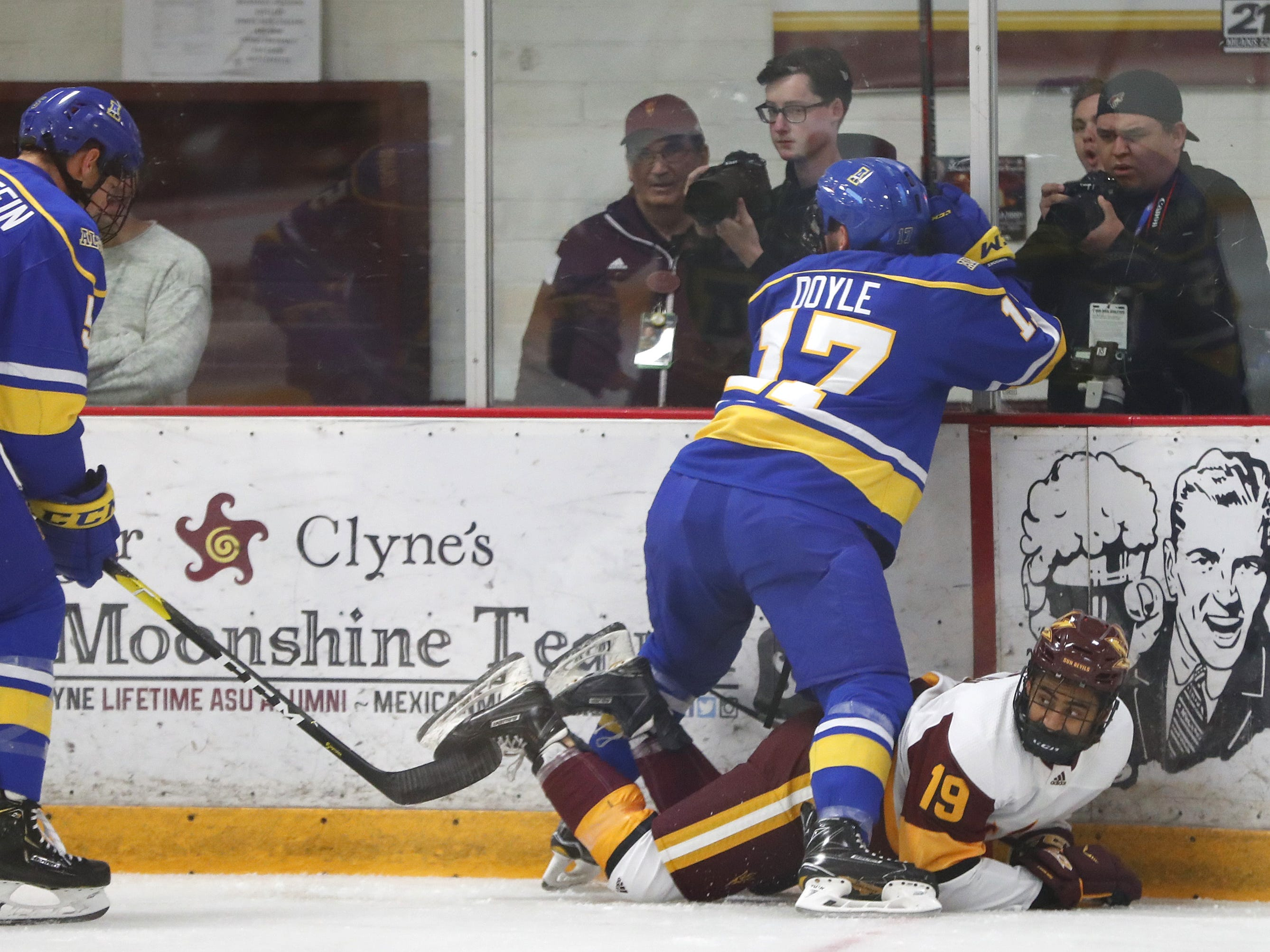 Alaska's Colin Doyle (17) checks ASU's Jordan Sandhu (19) into the boards at Oceanside Ice Arena in Tempe, Ariz. on October 7, 2018.