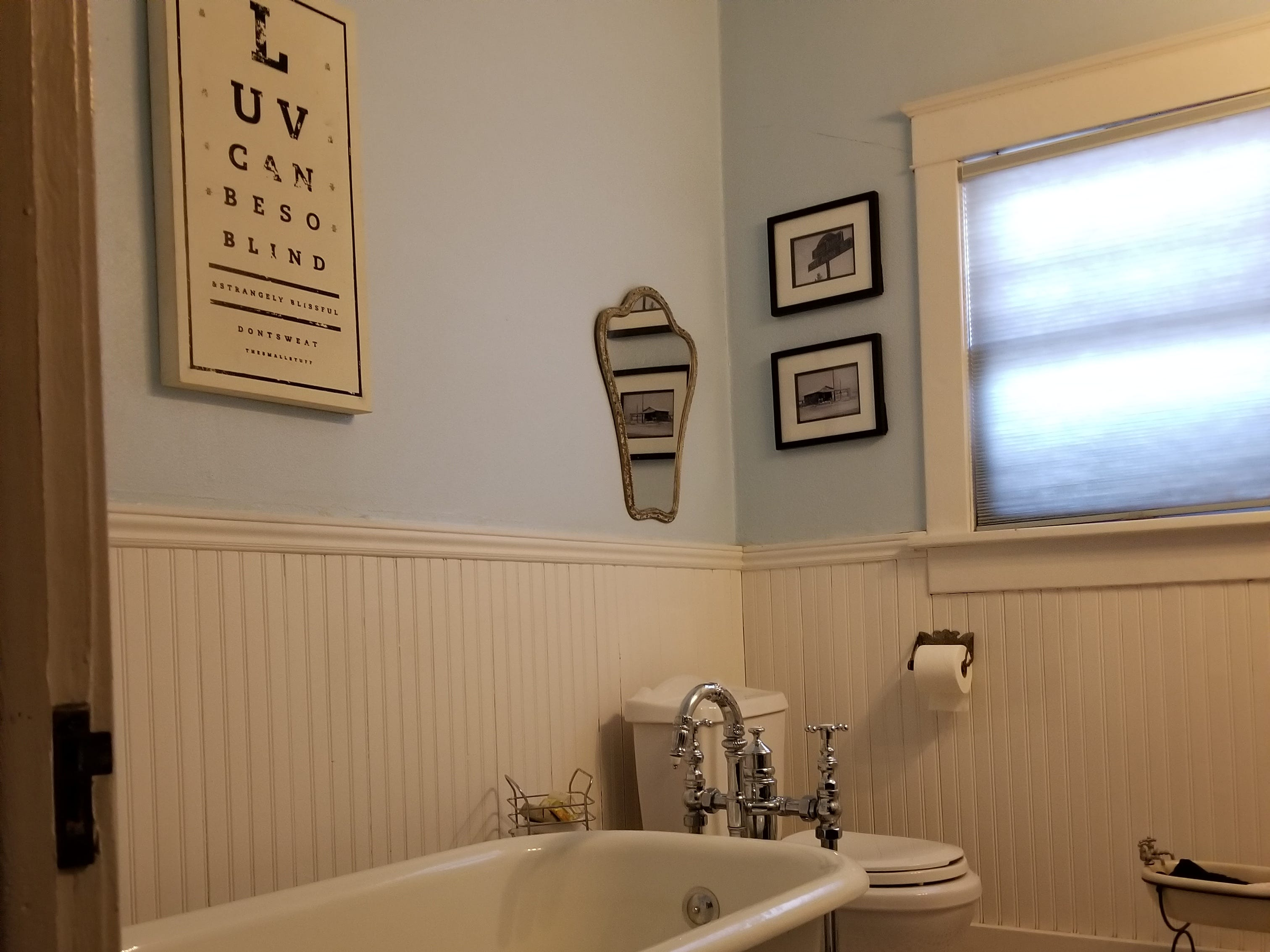 The guest bath is nestled between the parlor and guest bedroom. The tub is original to the home but required refinishing.