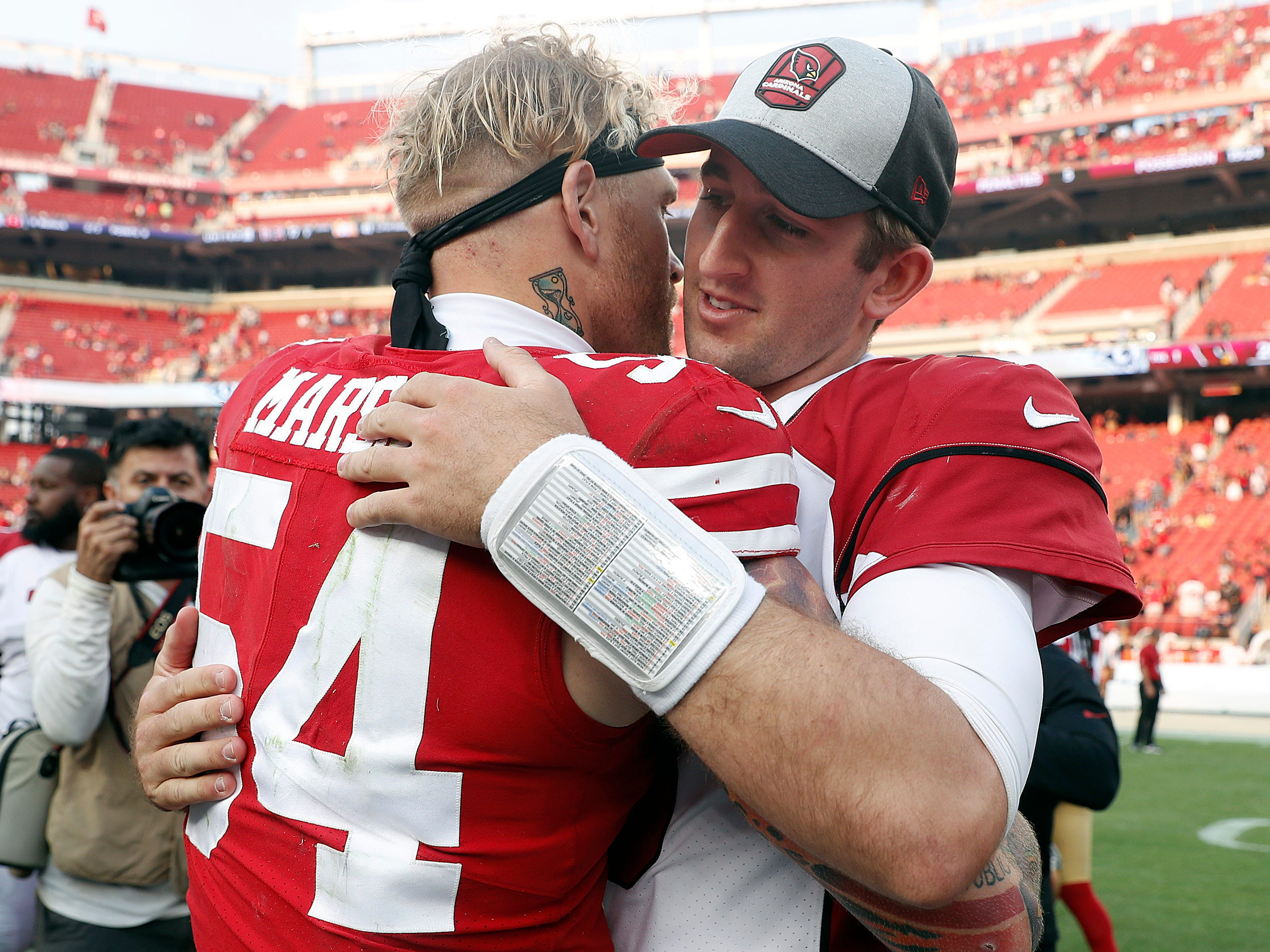 Arizona Cardinals quarterback Josh Rosen, right, hugs San Francisco 49ers defensive end Cassius Marsh after an NFL football game in Santa Clara, Calif., Sunday, Oct. 7, 2018.