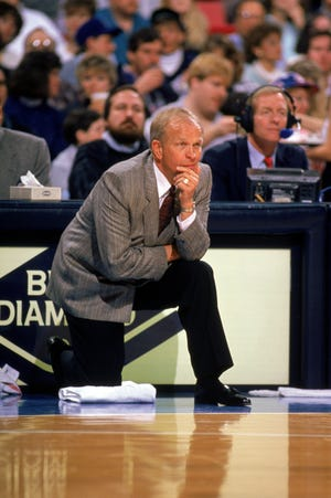 Head Coach Cotton Fitzsimmons of the Phoenix Suns looks on during a 1989 season NBA game at Veteran's Memorial Coliseum in Phoenix, Arizona.