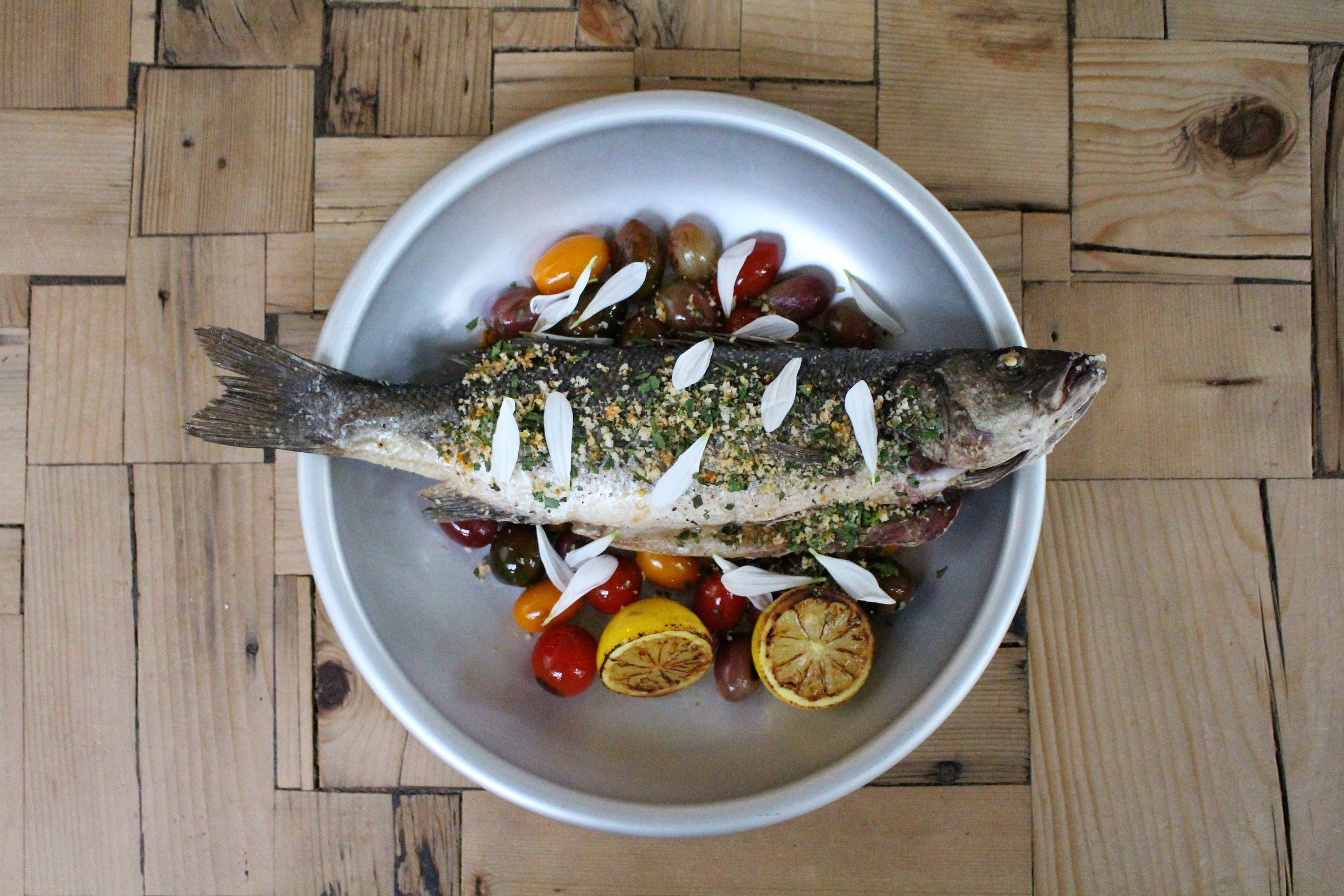 Whole branzino gets flavor from Bar Pesca's wood fired grill.