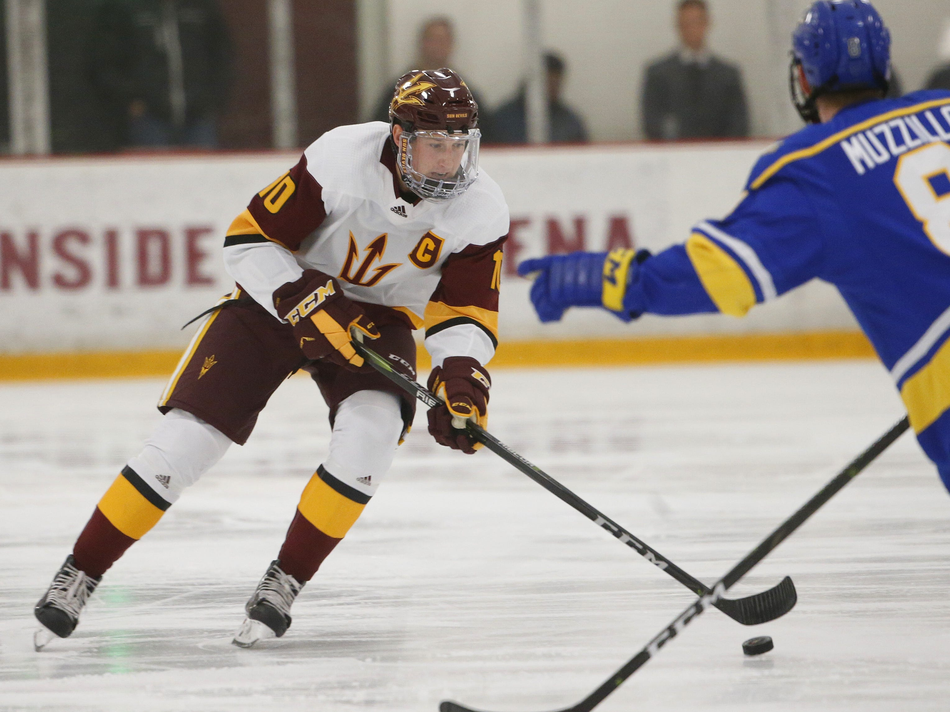 ASU's Tyler Busch (10) skates up the ice against Alaska's Jordan Muzzillo (8) at Oceanside Ice Arena in Tempe, Ariz. on October 7, 2018.