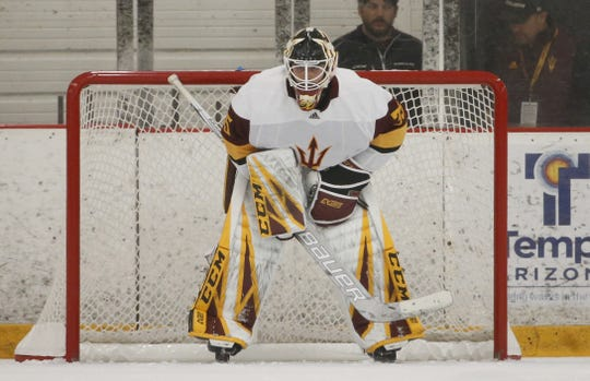 ASU's Joey Daccord (35) looks up the ice against Alaska at Oceanside Ice Arena in Tempe, Ariz. on October 7, 2018.