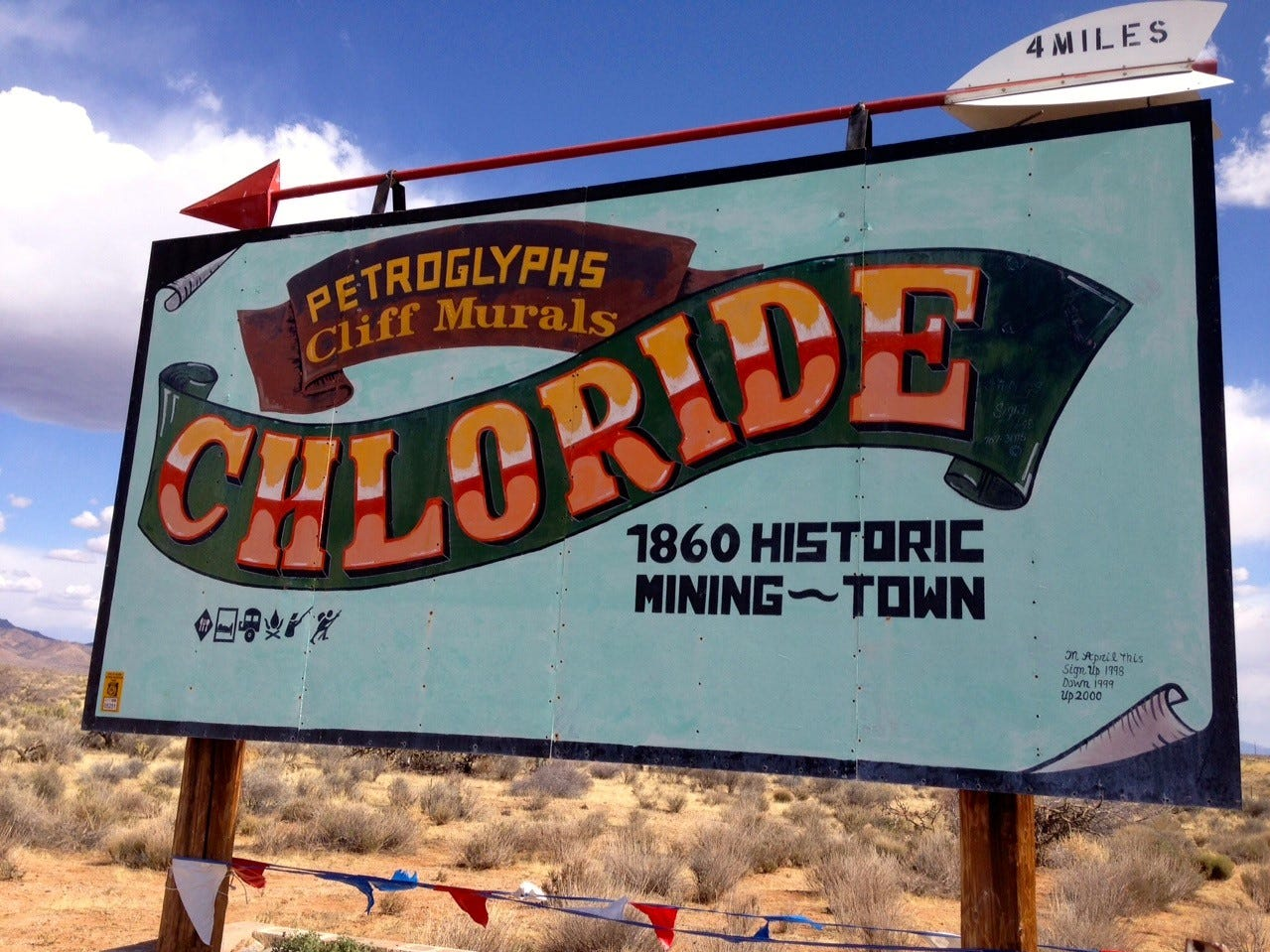 North of Kingman, Chloride is a former mining town now known for murals by artist Roy Purcell painted on the boulders outside of town.