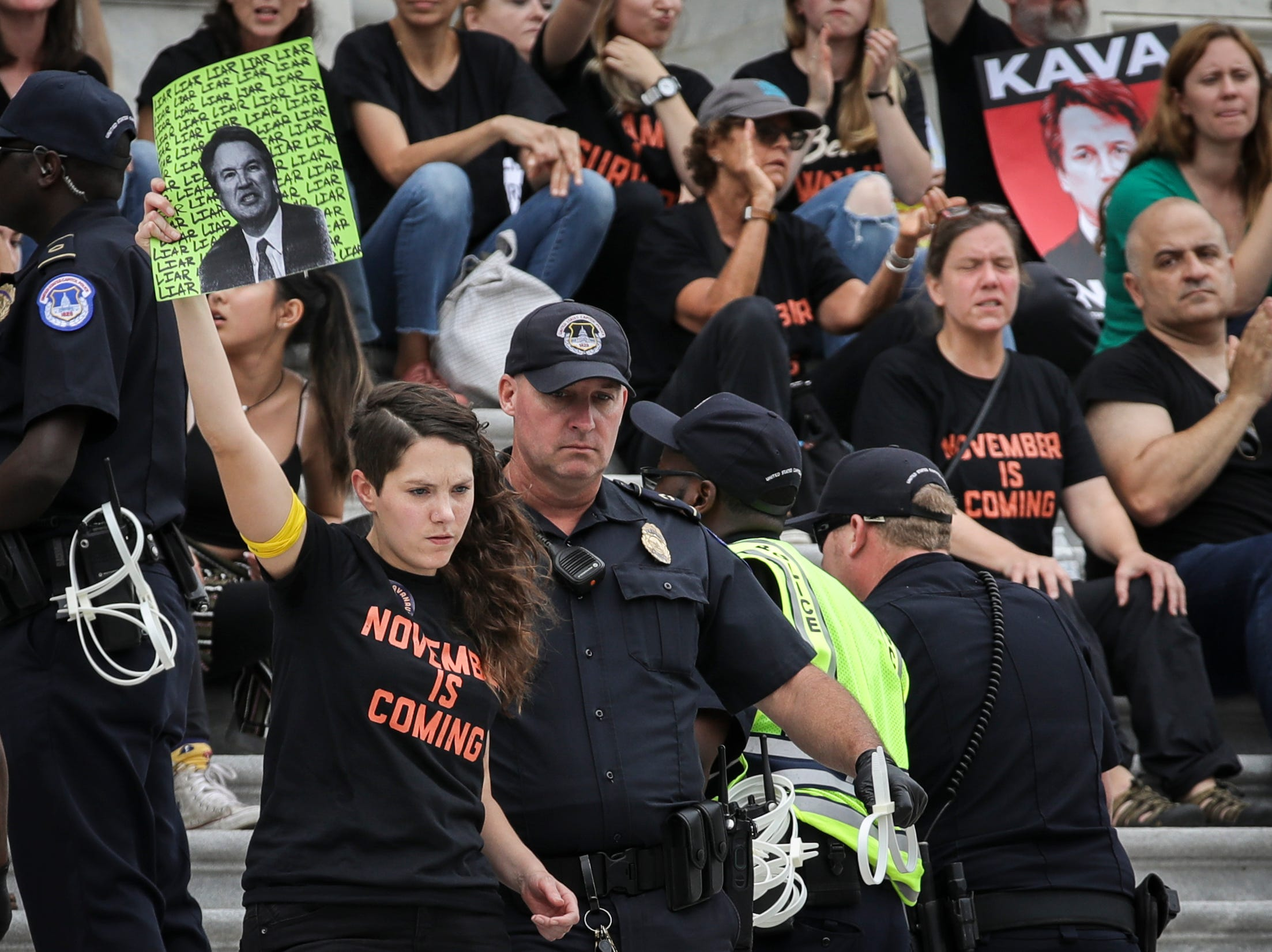 WASHINGTON, DC - OCTOBER 6: A protester is arrested as demonstrators occupy the steps on the East Front of the U.S. Capitol in protest of Supreme Court nominee Judge Brett Kavanaugh, October 6, 2018 in Washington, DC. Hundreds were arrested by Capitol Police during the demonstration. The Senate is set to hold a final vote Saturday evening to confirm the nomination of Judge Brett Kavanaugh to the U.S. Supreme Court. (Photo by Drew Angerer/Getty Images)